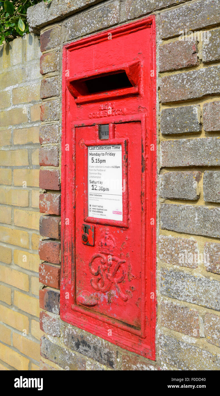 Wall mounted British Royal Mail red letter box from the reign of King George VI in England, UK. - Stock Image