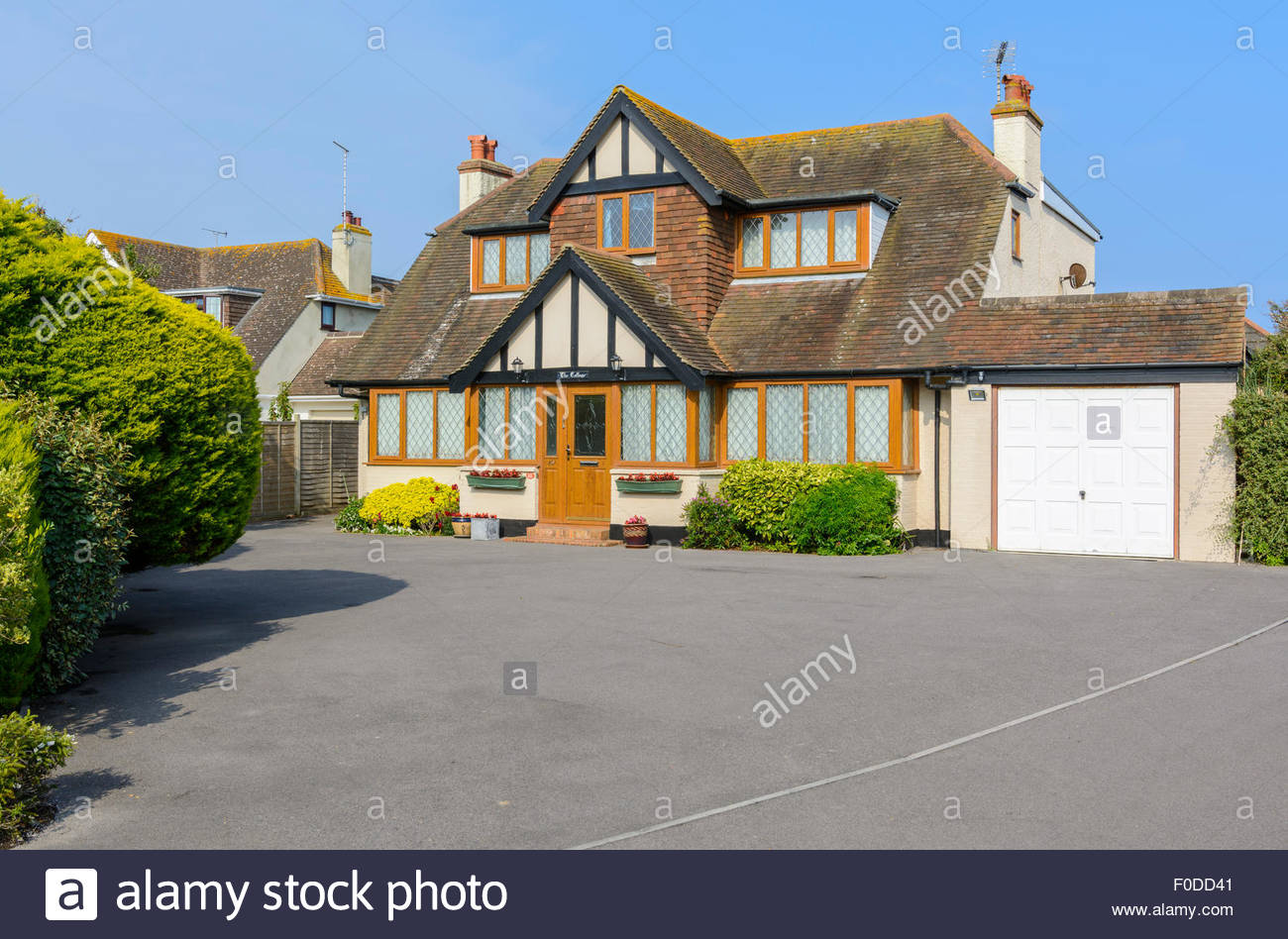 Large detached house with a garage and big driveway in West Sussex, England, UK. - Stock Image
