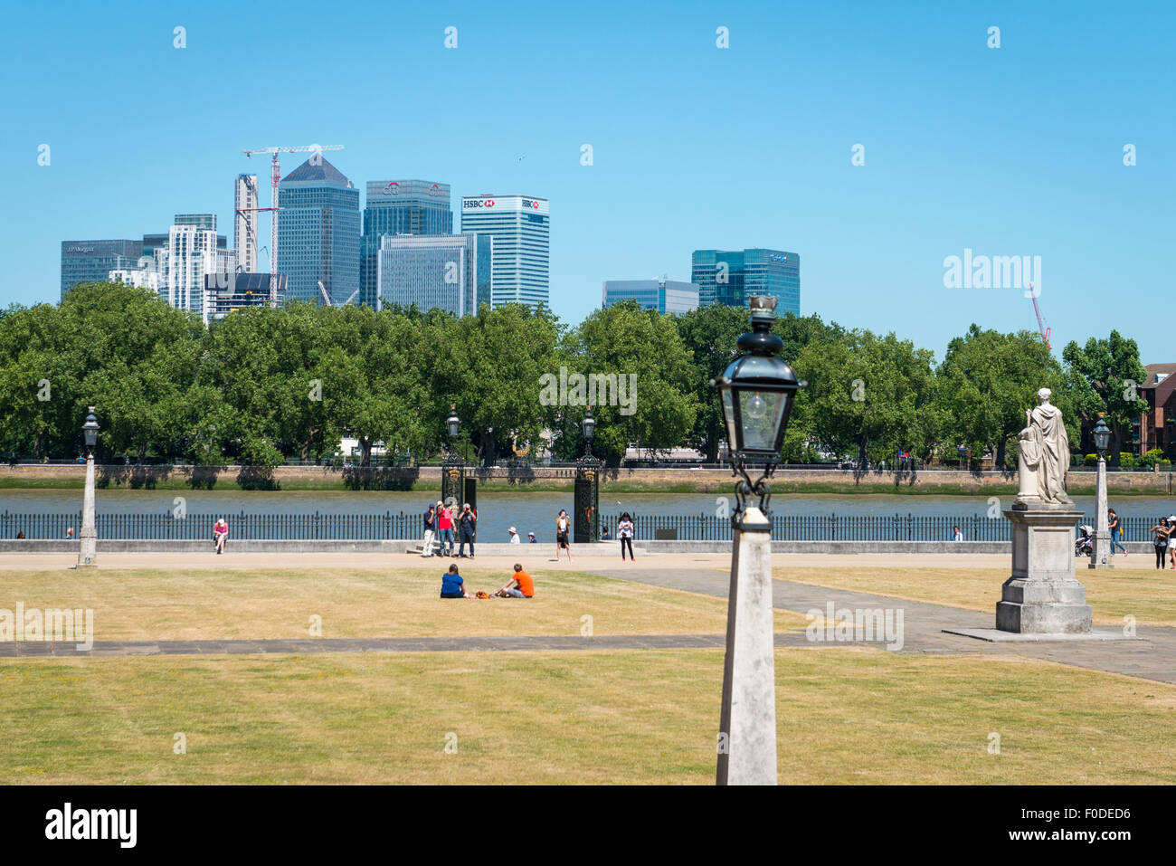 London Southbank Greenwich University lawns statue sculpture Water Gate River Thames Canary Wharf blue sky summer - Stock Image