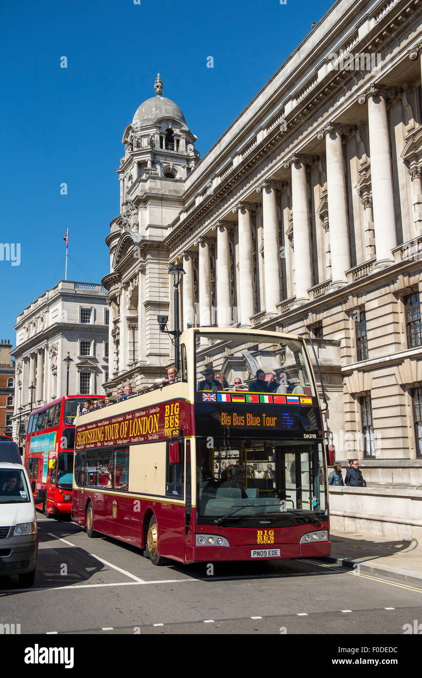 Open top sightseeing bus touring the City of London, England. - Stock Image