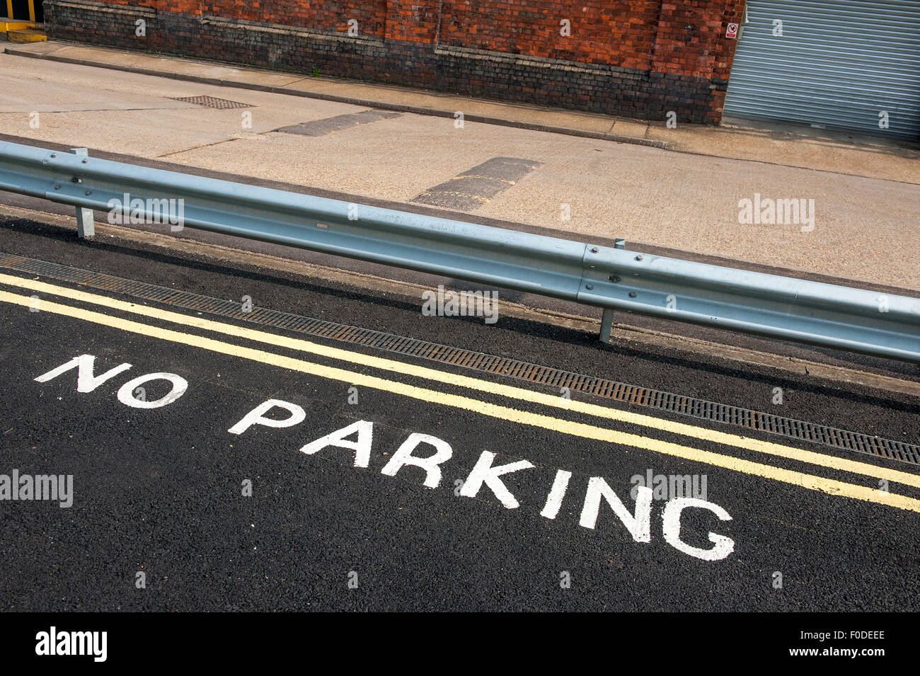 Double yellow lines in a no parking zone in England; - Stock Image