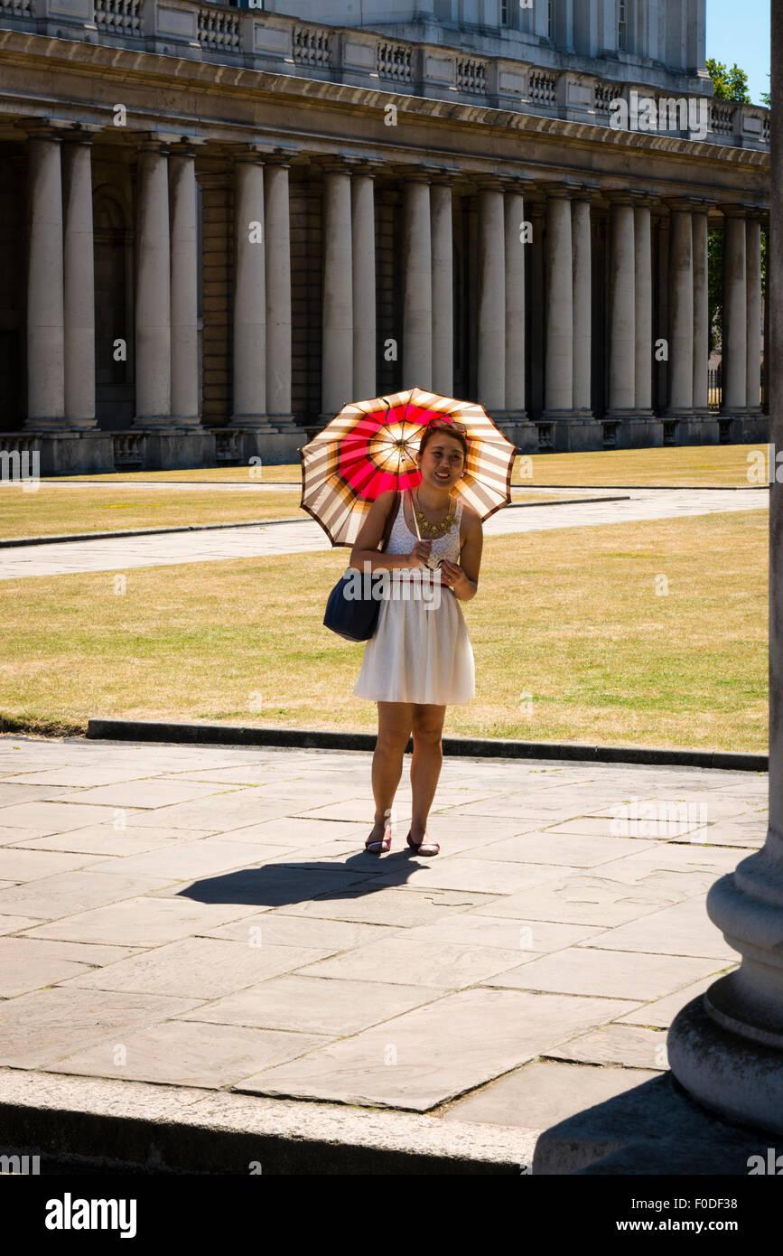 London Southbank Greenwich University built Sir Christopher Wren & Nicholas Hawksmoor Japanese tourist poses umbrella Stock Photo