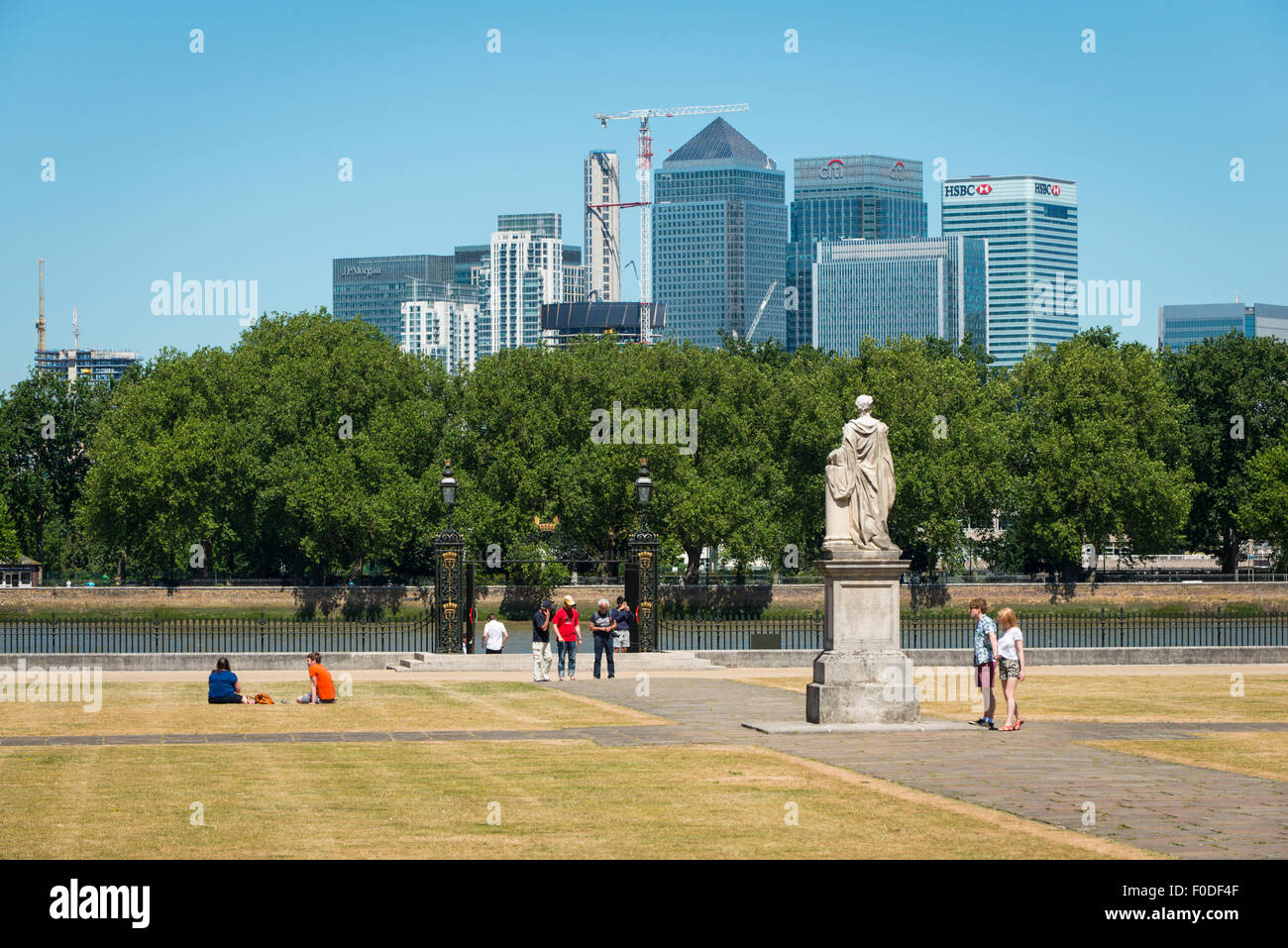 London Southbank Greenwich University grounds view of Water Gate towards Canary Wharf over River Thames people grass Stock Photo