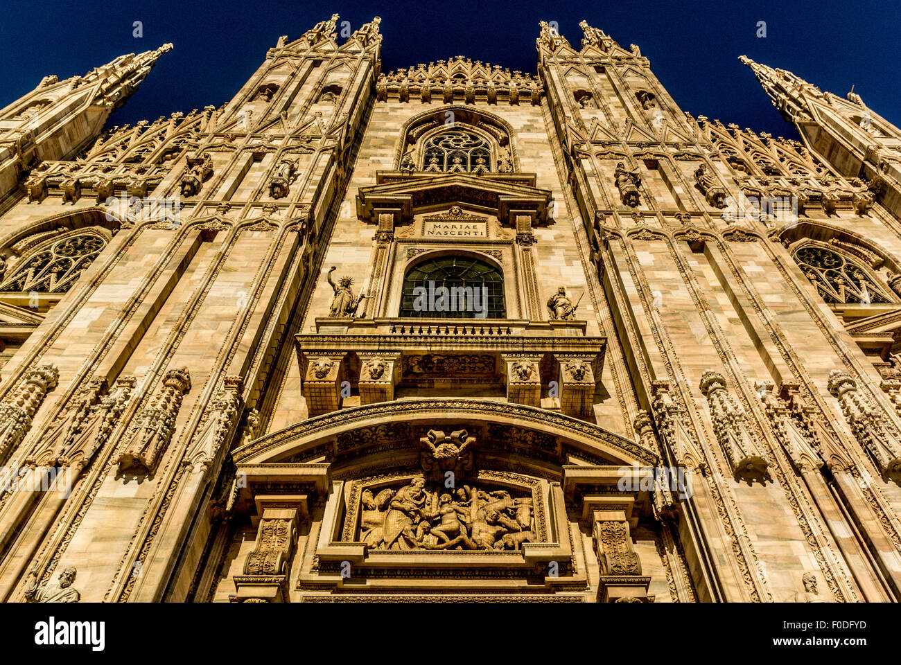 Wide angle view of exterior Milan Cathedral shot from a low angle looking upwards - Stock Image