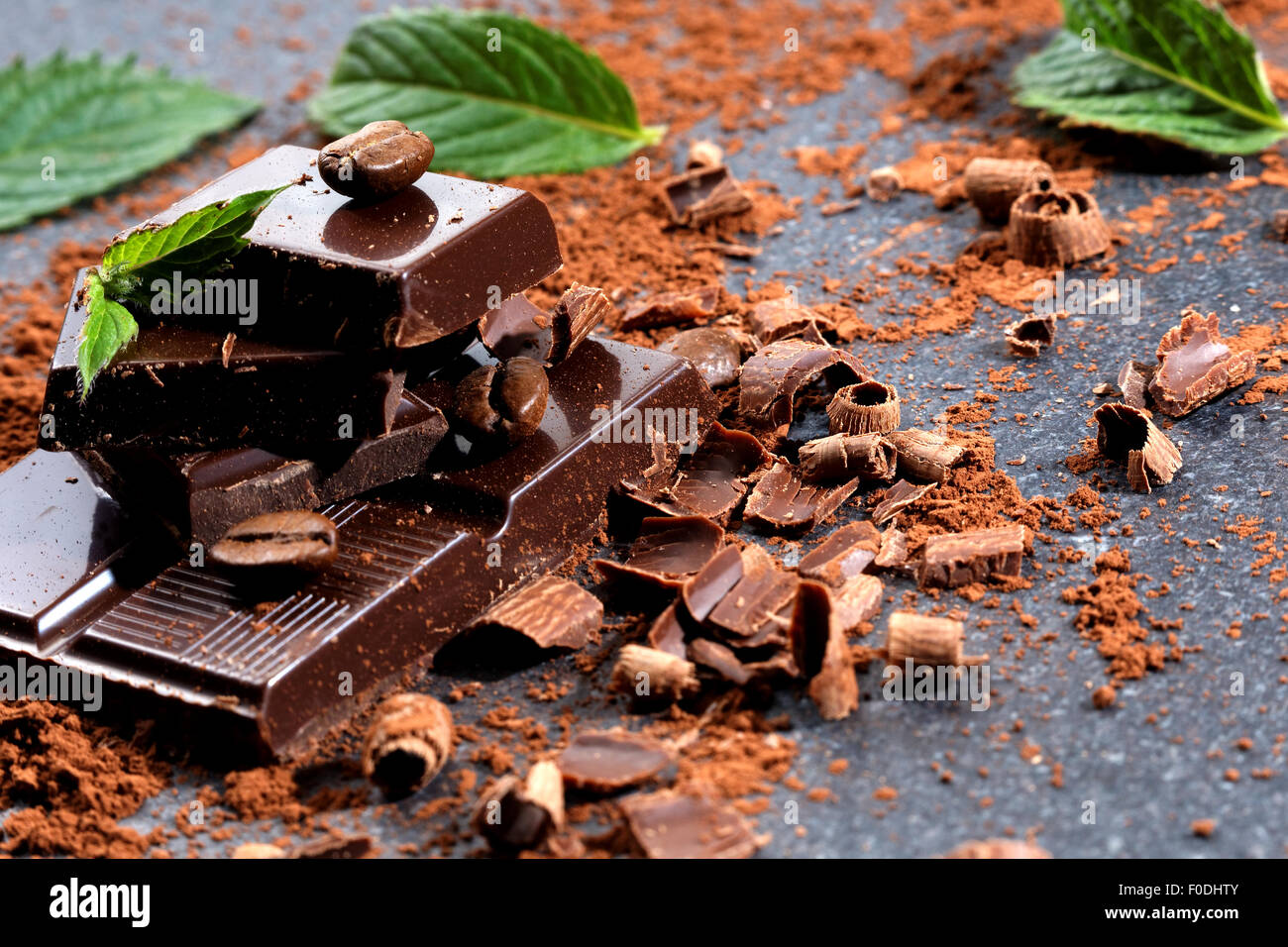 Dark chocolate and coffee bean on a stone table - Stock Image