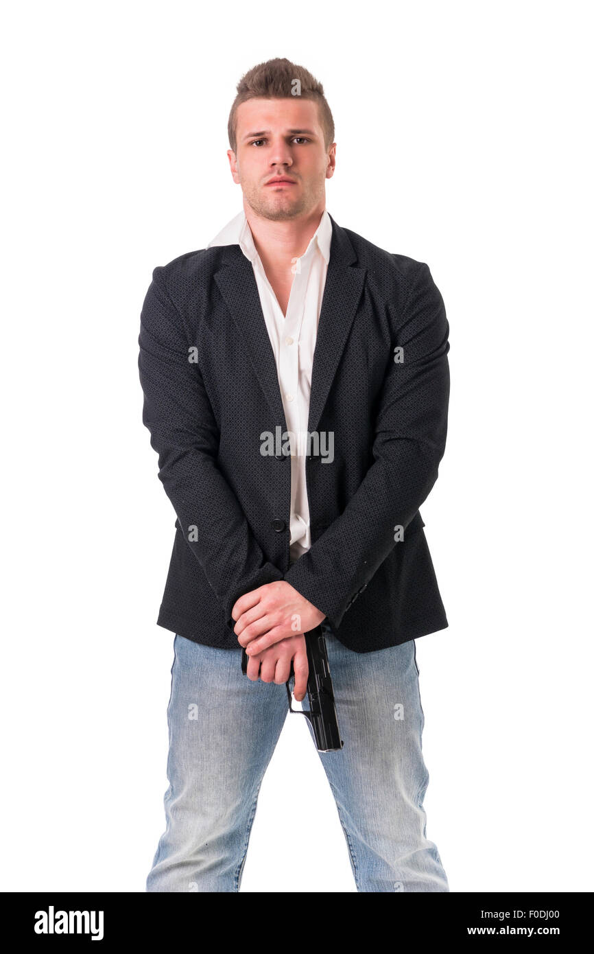 Elegant man with gun, dressed as a spy or secret agent, with earphones, isolated on white - Stock Image
