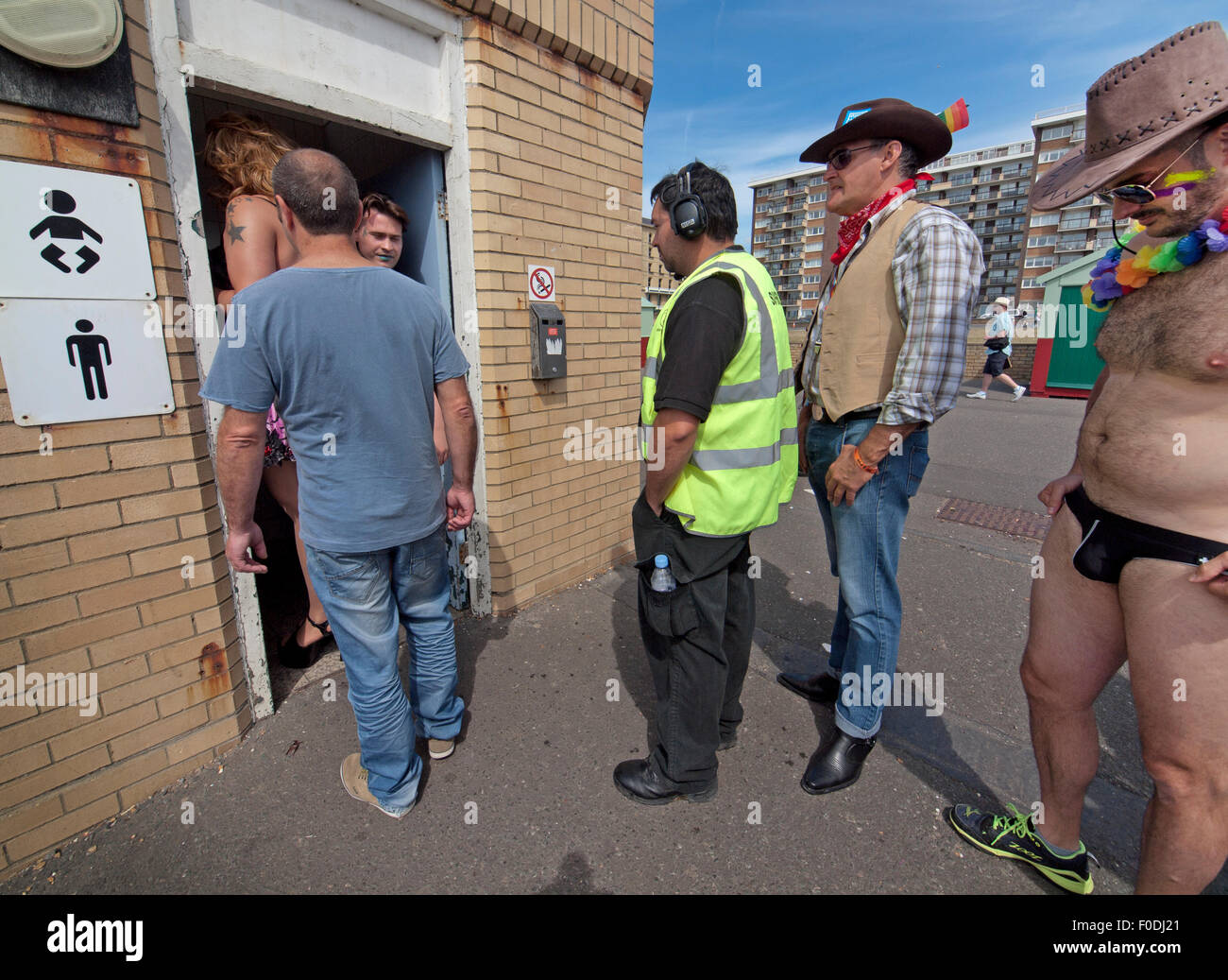 Revelers wait to use the toilet on Hove seafront for Brighton Gay Pride  2015 - Stock