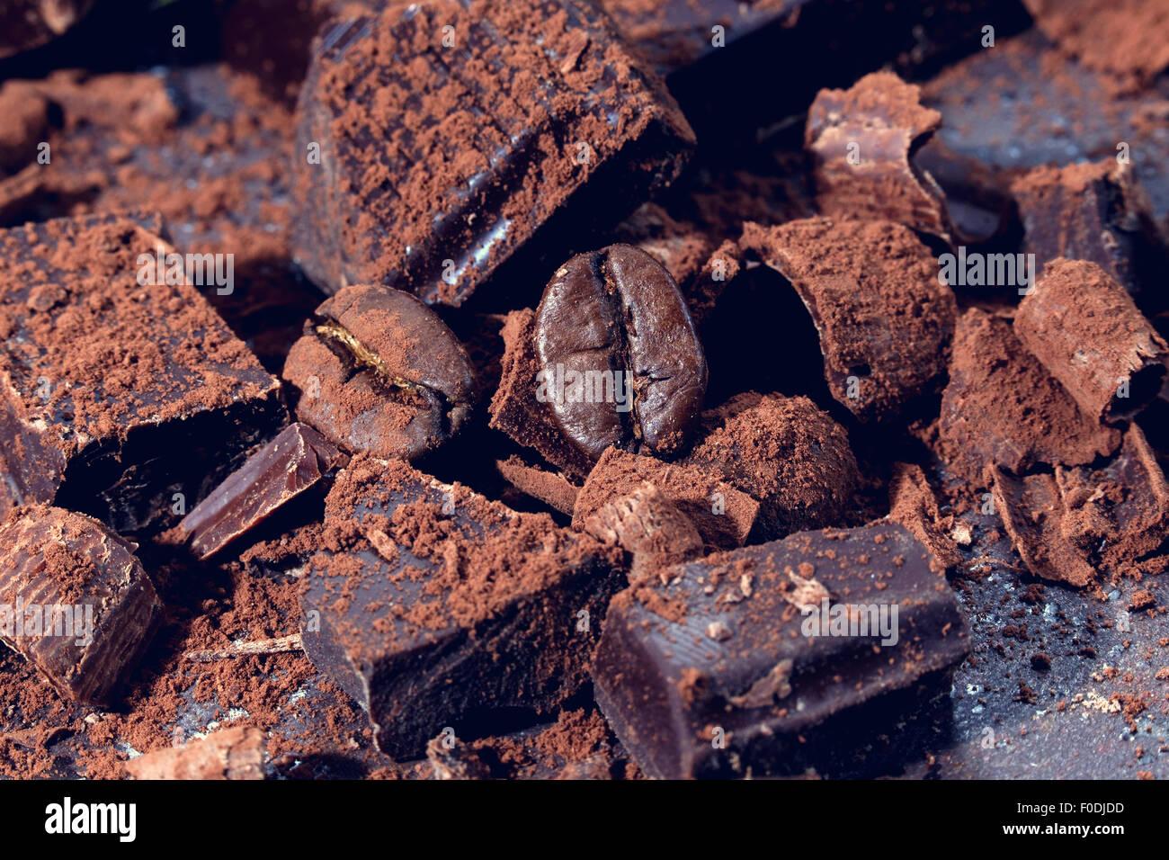Broken dark chocolate on a wooden table Stock Photo