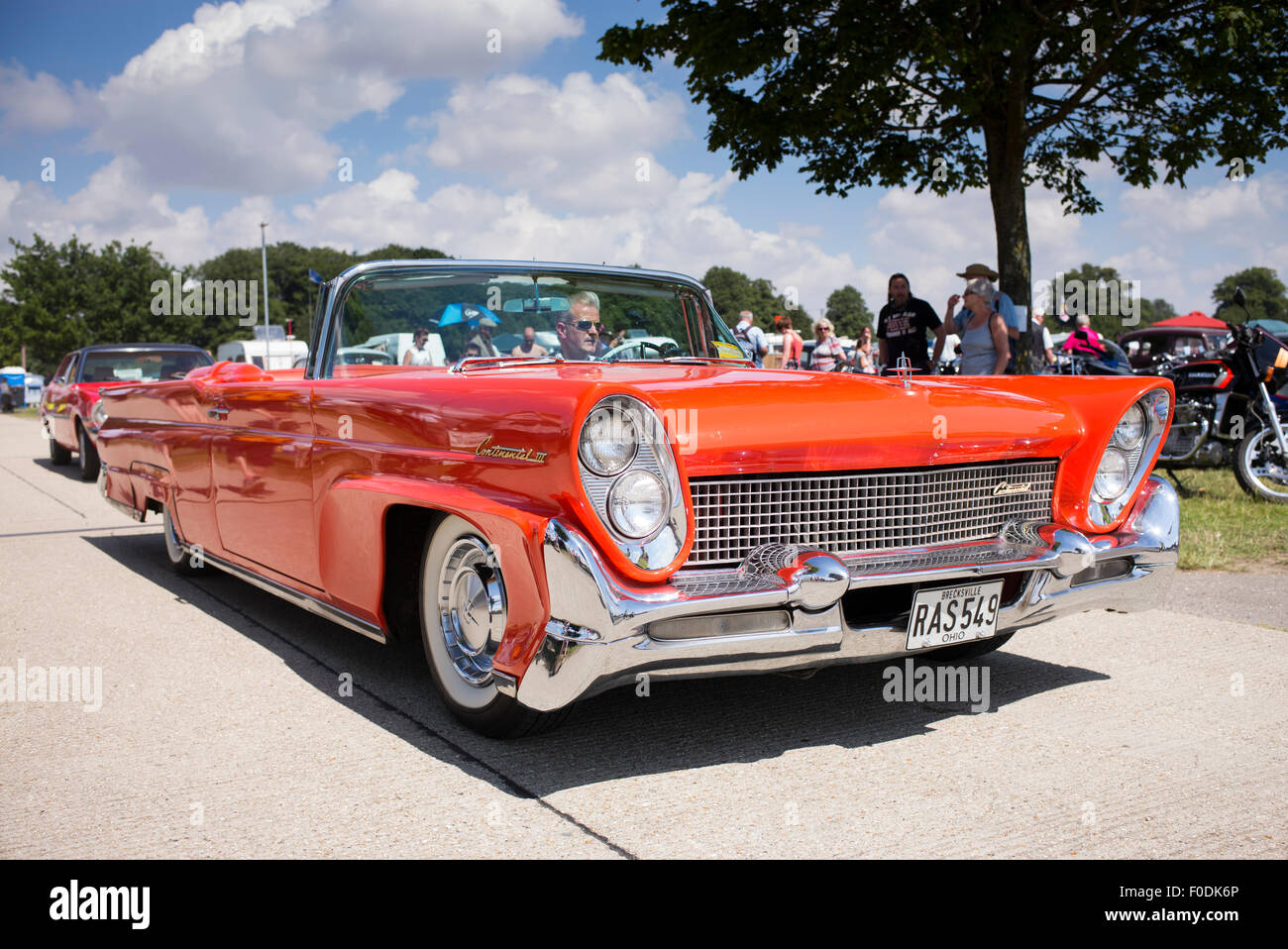 Man Driving A Vintage 1958 Lincoln Continental Mark 3 Car At A Stock