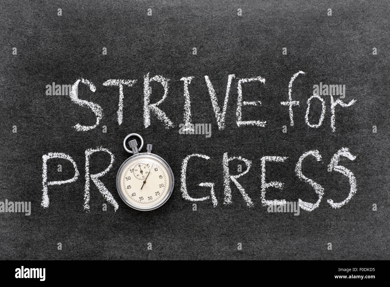 strive for progress phrase handwritten on chalkboard with vintage precise stopwatch used instead of O - Stock Image