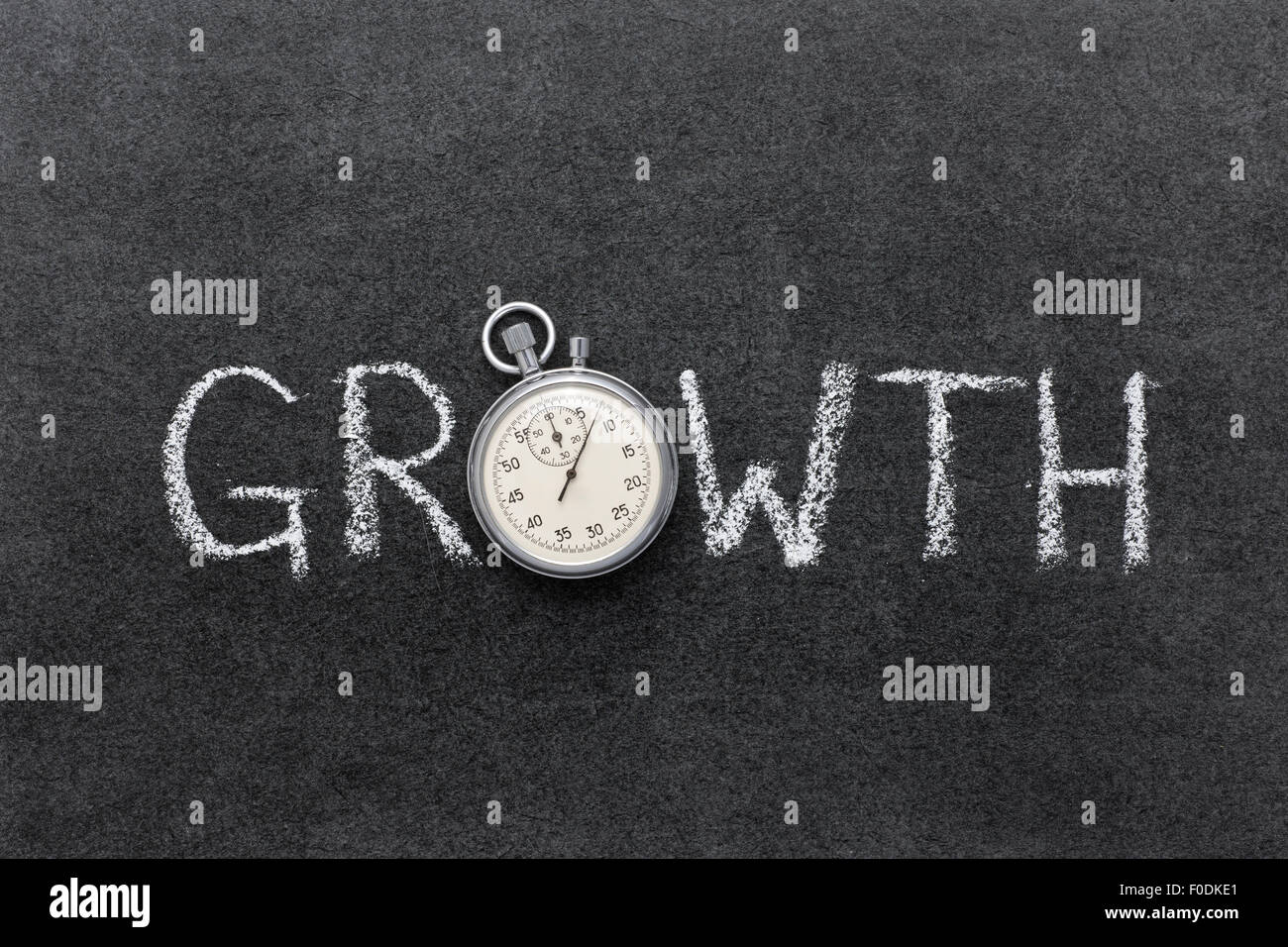 growth concept handwritten on chalkboard with vintage precise stopwatch used instead of O - Stock Image