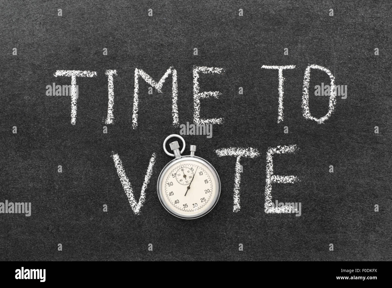 time to vote phrase handwritten on chalkboard with vintage precise stopwatch used instead of O - Stock Image