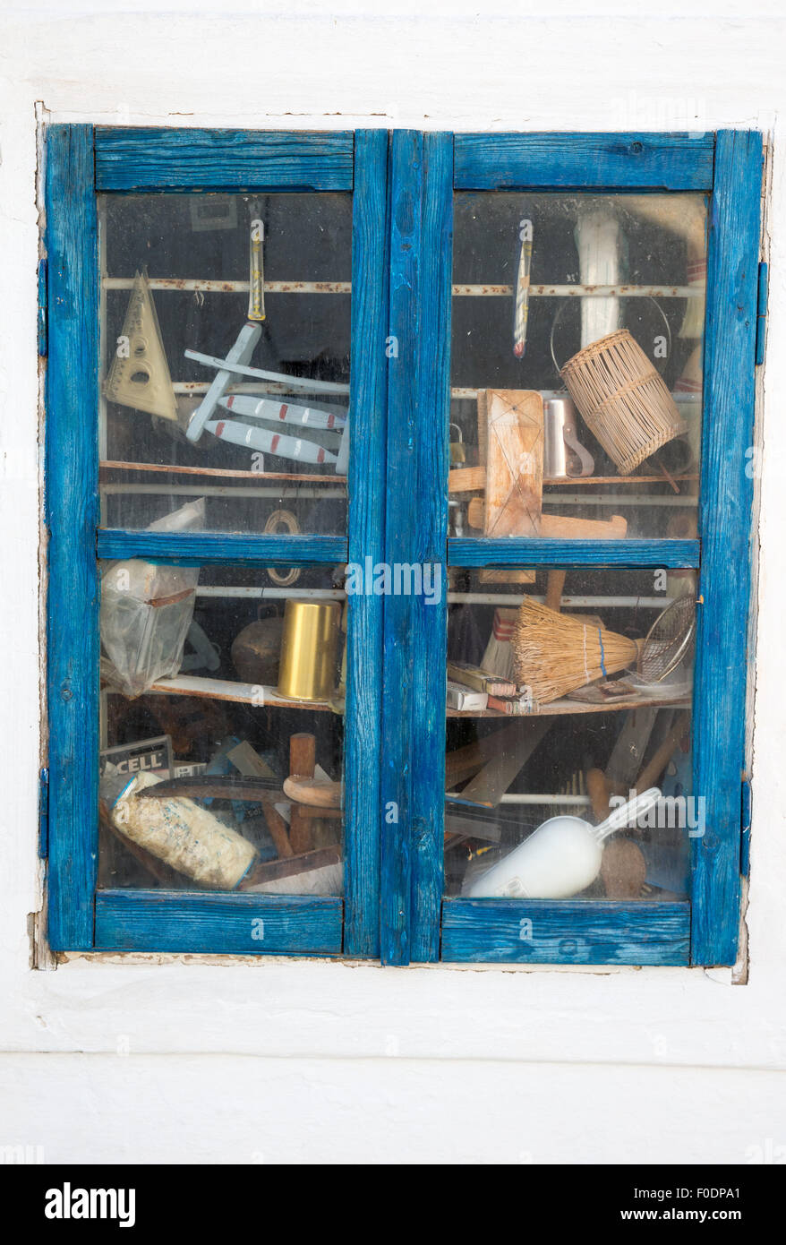 Window of a carpenters shop in a village in Greece - Stock Image