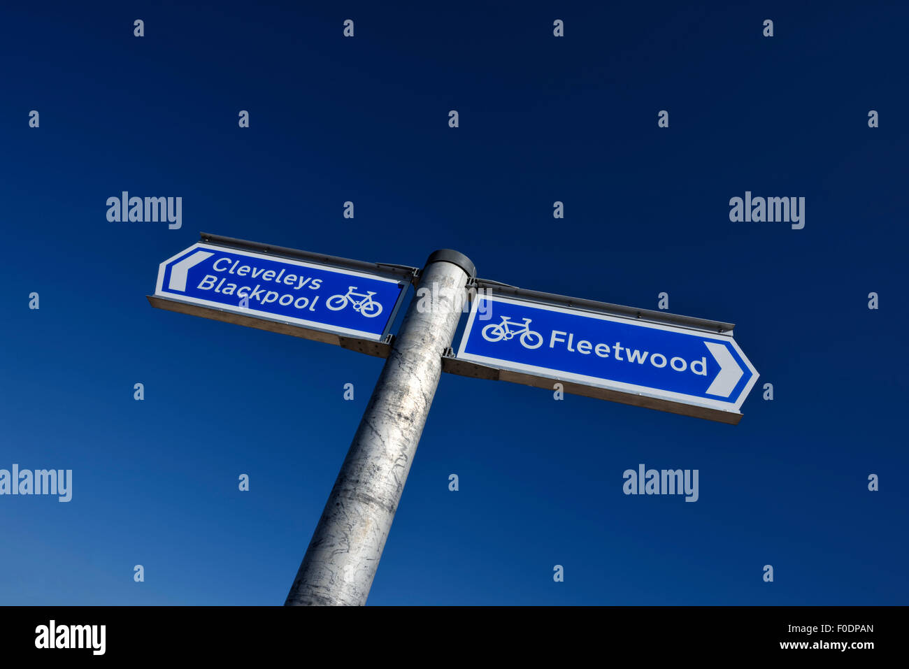 Signpost indicate the cycling route to Cleveleys, Blackpool and Fleetwood - Stock Image