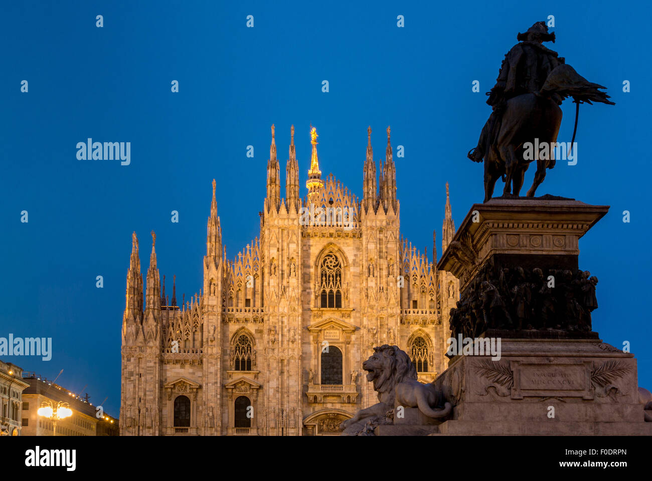 Milan Cathedral with the statue of King Victor Emmanuel II at dusk. Milan, Italy - Stock Image