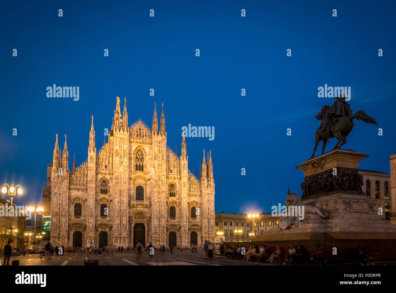 Milan Cathedral with the statue of King Victor Emmanuell II at dusk. Milan, Italy - Stock Image
