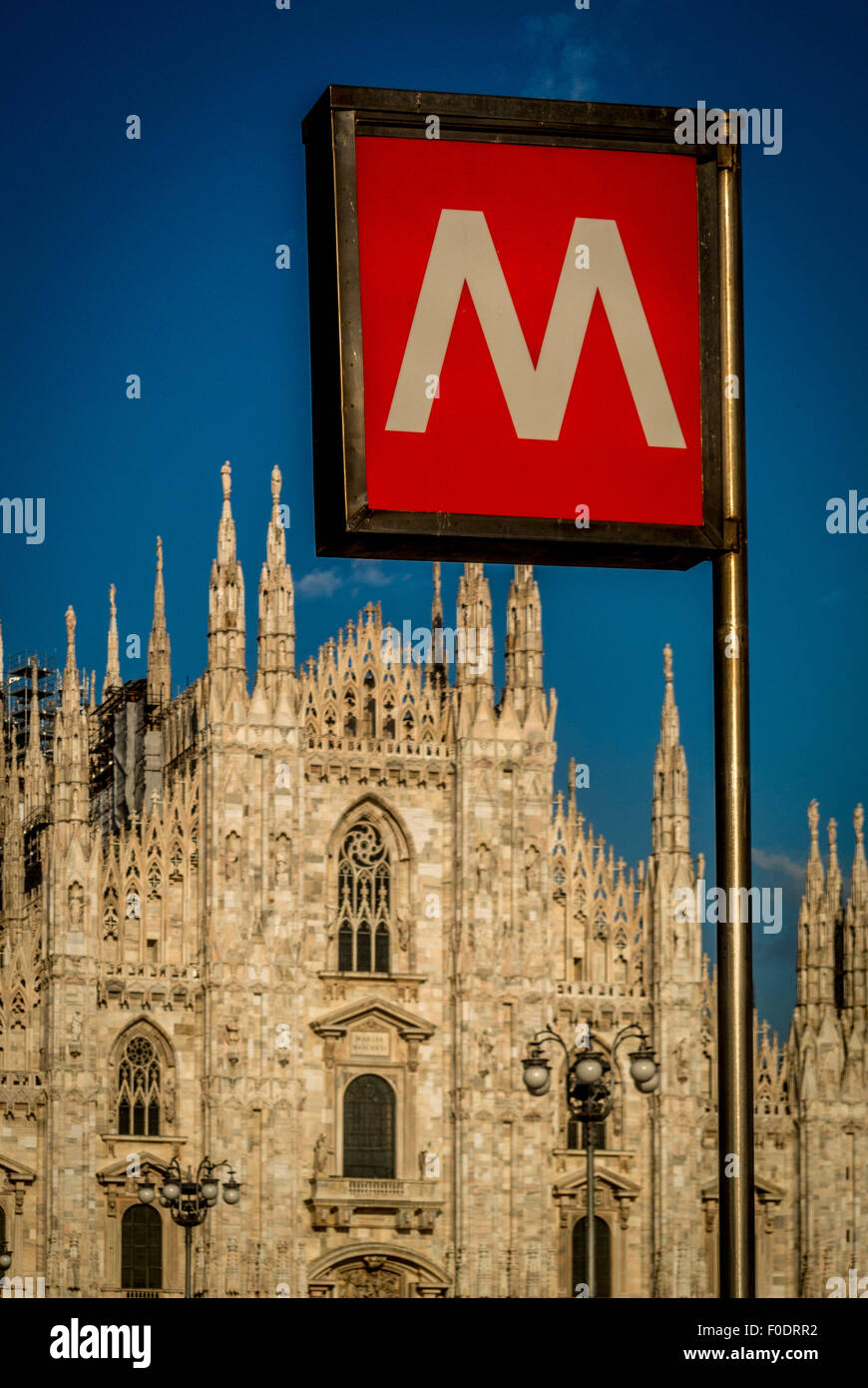 Milan Cathedral with a metro sign outside. - Stock Image