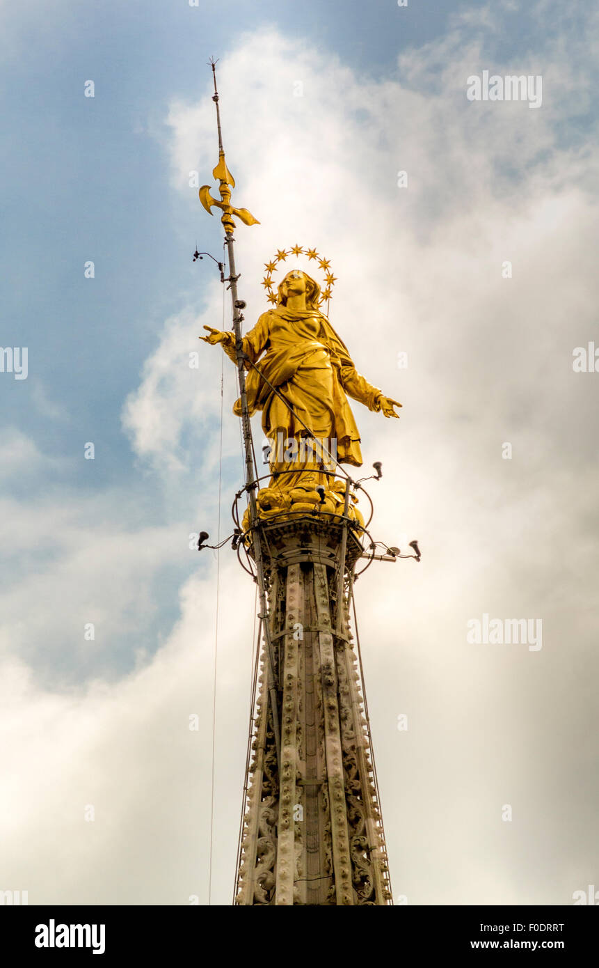 Gold leaf covered statue of the Virgin Mary on the Madonnina spire, on Milan Cathedral. - Stock Image