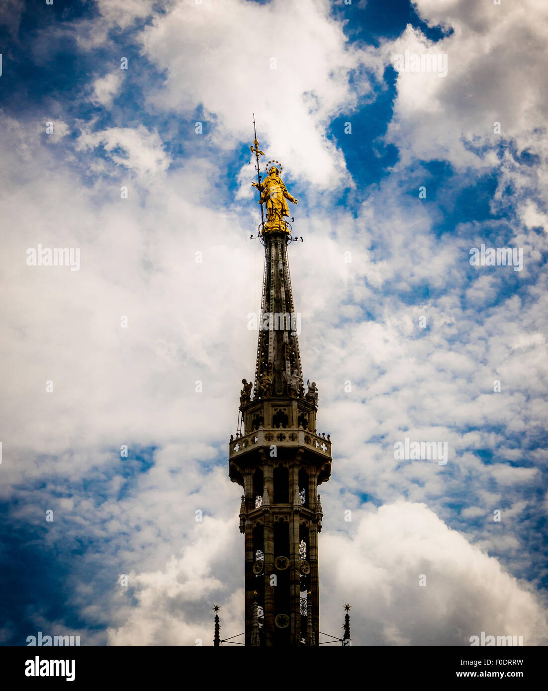 Spire with statue of Virgin Mary. Milan Cathedral. Italy - Stock Image