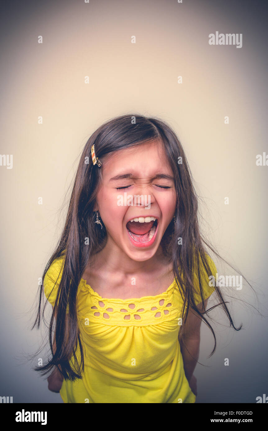 Young girl screaming loudly - Stock Image