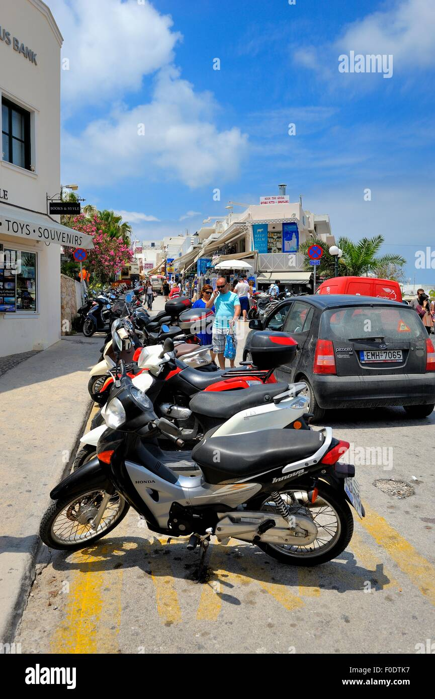Motor bikes parked in a busy street in Thira Santorini Greece - Stock Image
