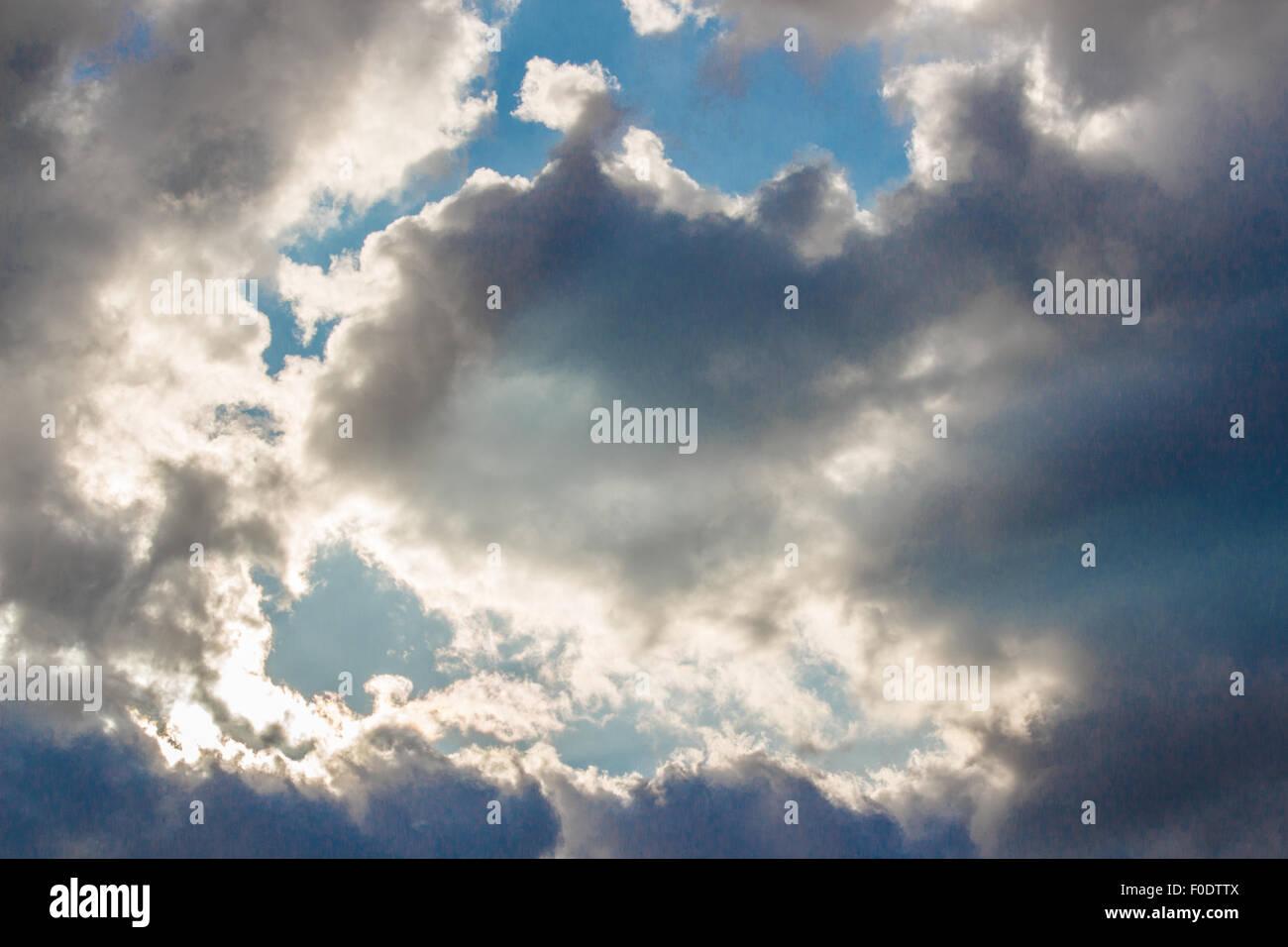 Dark clouds cover the blu sky - Stock Image