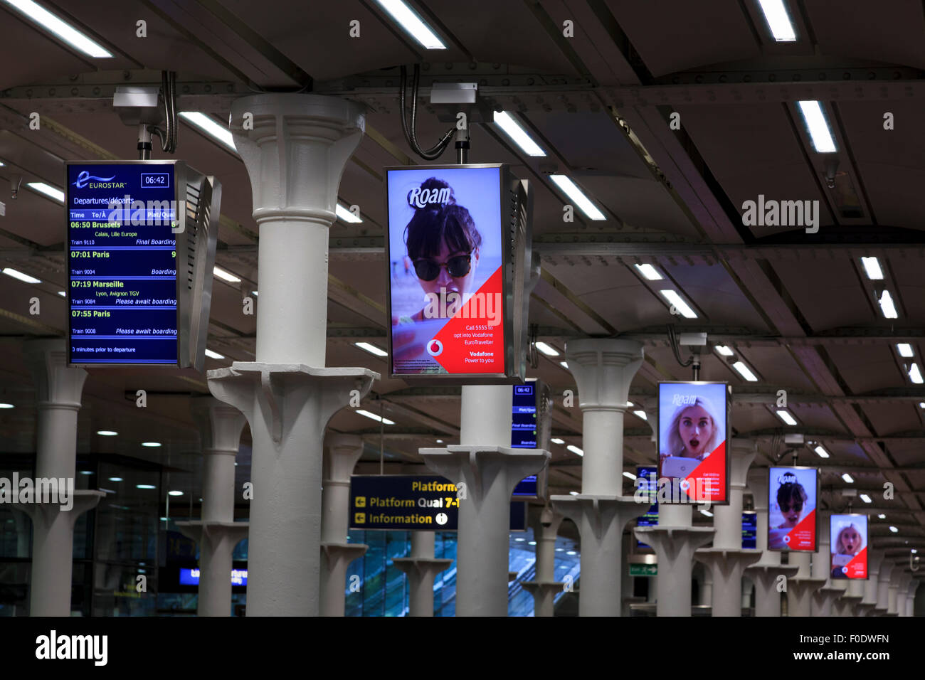 Advertising display screens at the Eurostar Terminal at St Pancras - Stock Image
