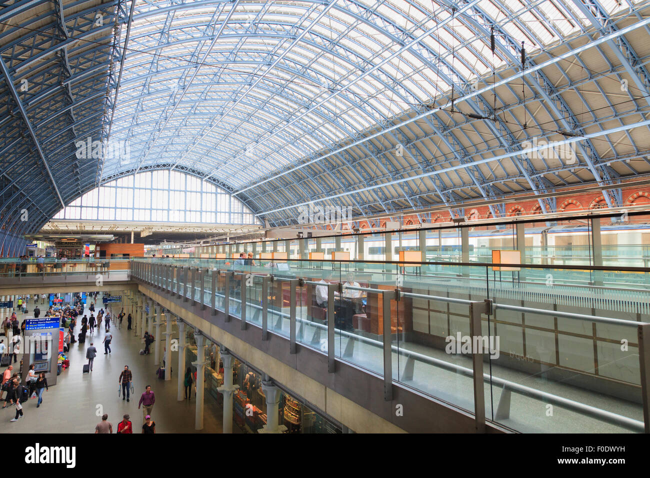 Inside the grade 1 listed St Pancras Railway Station with glazed roof - Stock Image
