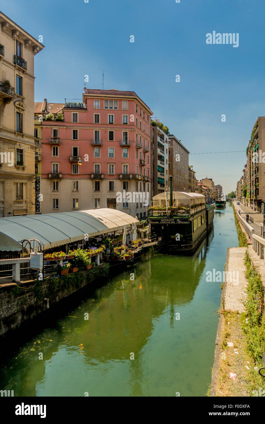 Moored boats on the canal in the Navigli district of Milan. Italy. - Stock Image