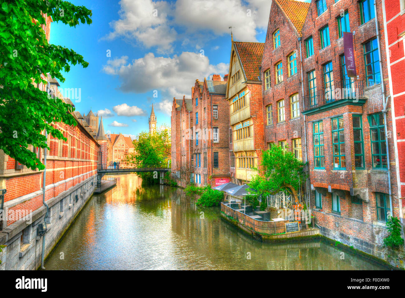 Beautiful canal at Ghent with river boats and medieval buildings photo done in HDR - Stock Image