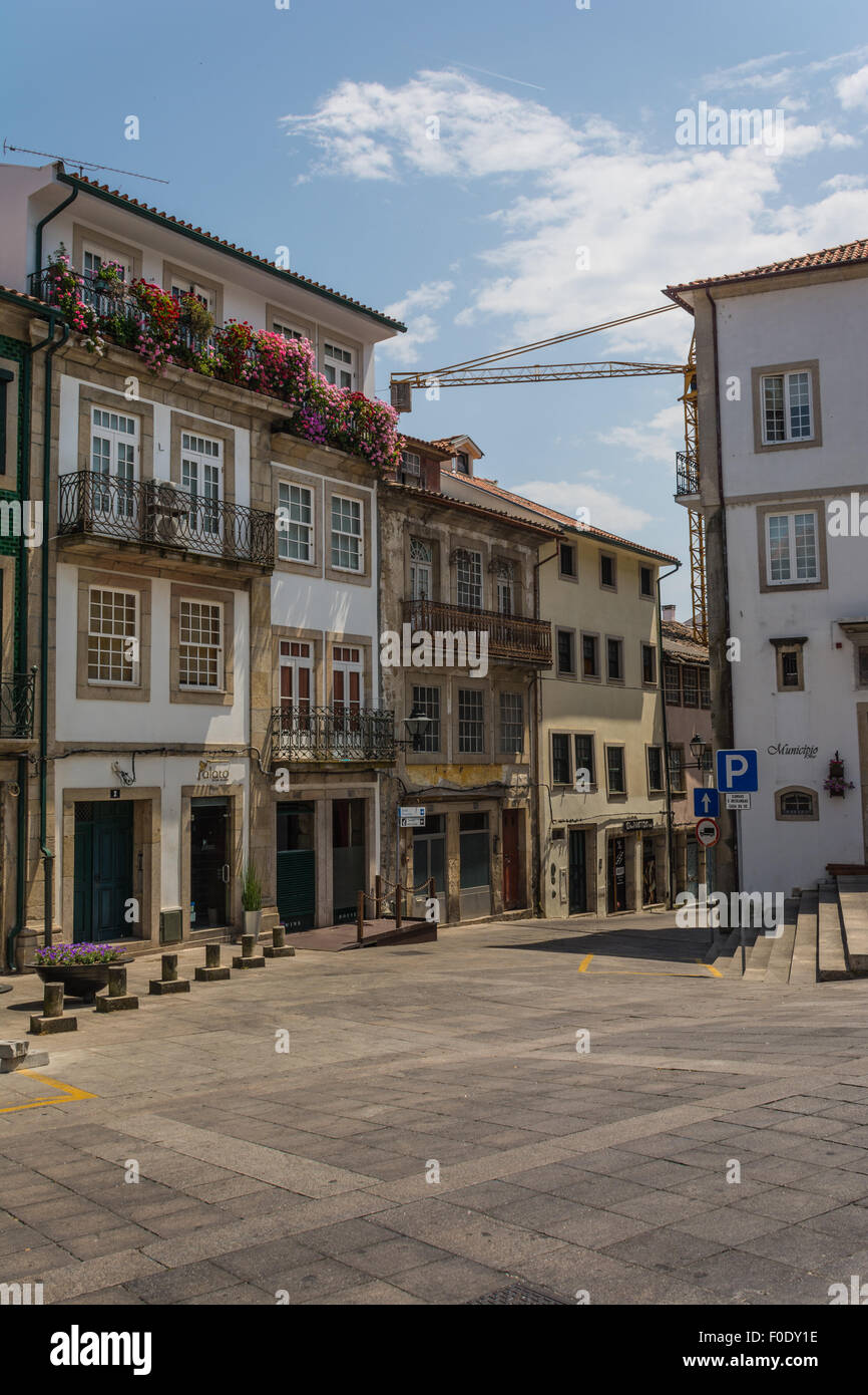 Square with shops and houses to the rear of cathedral in historic town centre of Viseu, Portugal - Stock Image