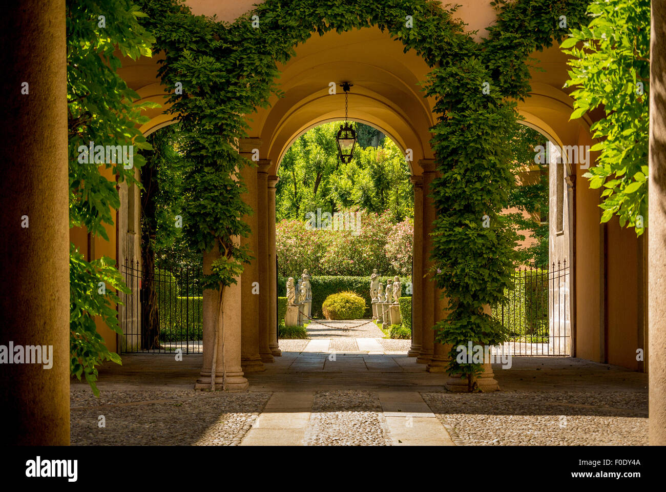 Archway leading to a courtyard - Stock Image