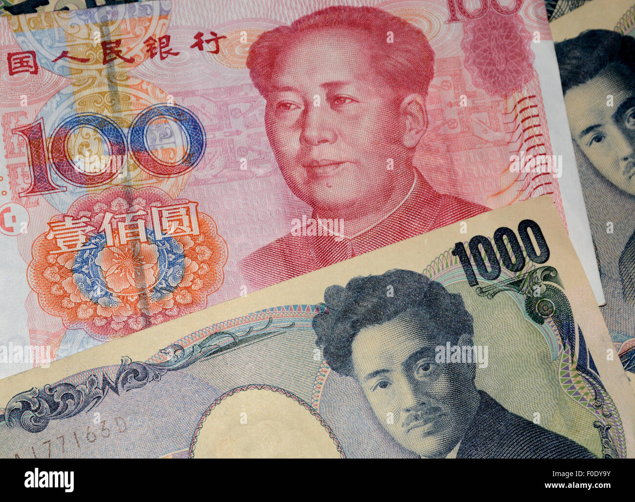 chinese Yuan and japanese yen - Stock Image