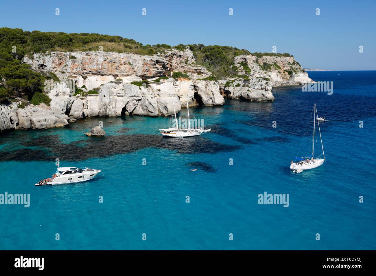 Yachts anchored in cove, Cala Macarella, near Cala Galdana, South West Coast, Menorca, Balearic Islands, Spain, - Stock Image