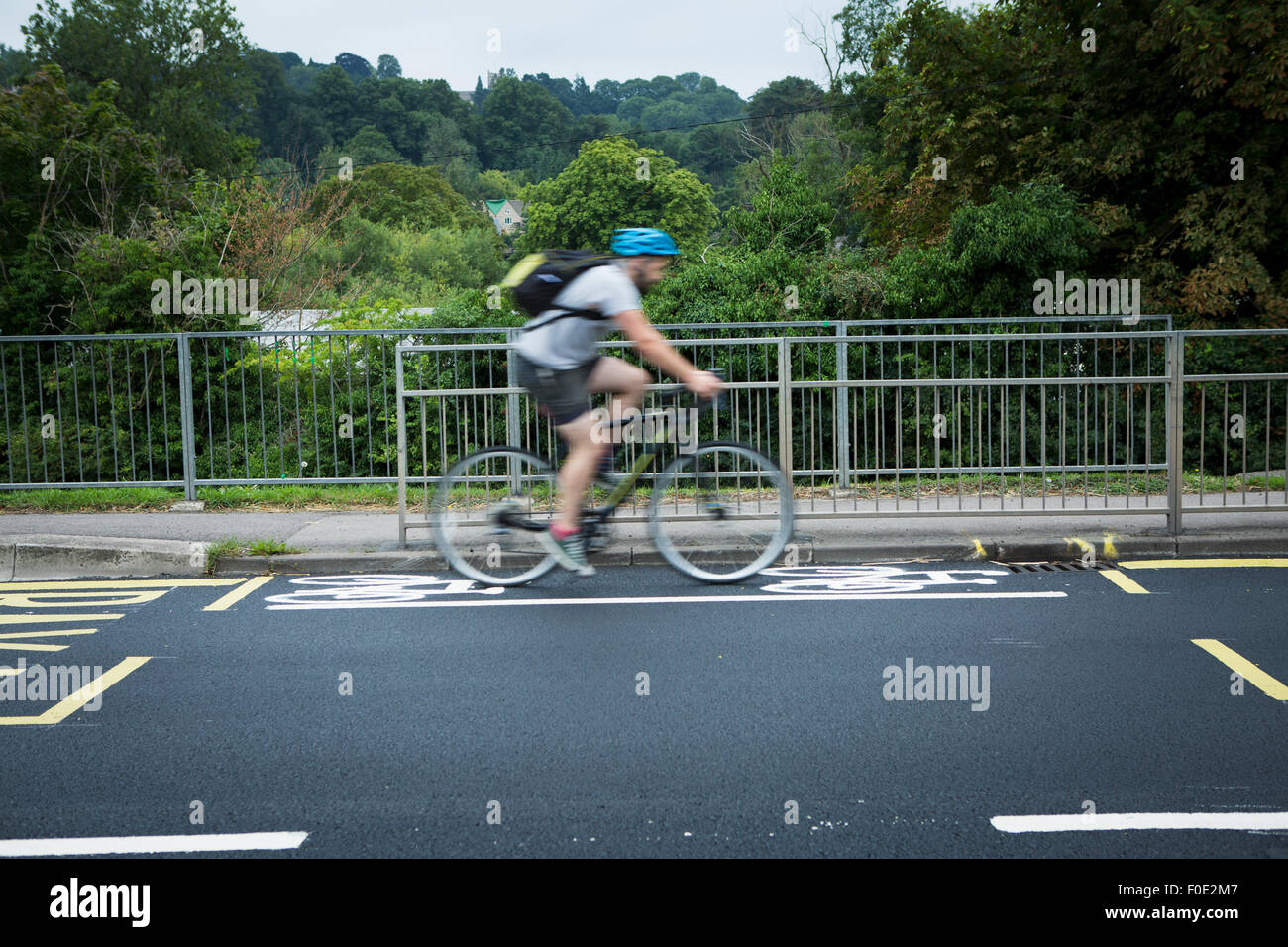 Stroud, UK. 11th Aug, 2015. Britain's shortest cycle lane is painted on a newly tarmacced road between two school - Stock Image