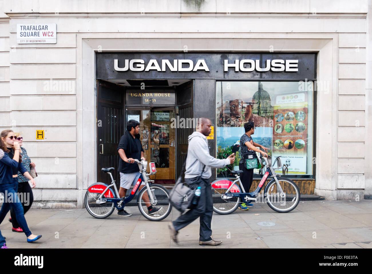 People outside Uganda House, the Uganda High Commission, Trafalgar Square, London UK - Stock Image