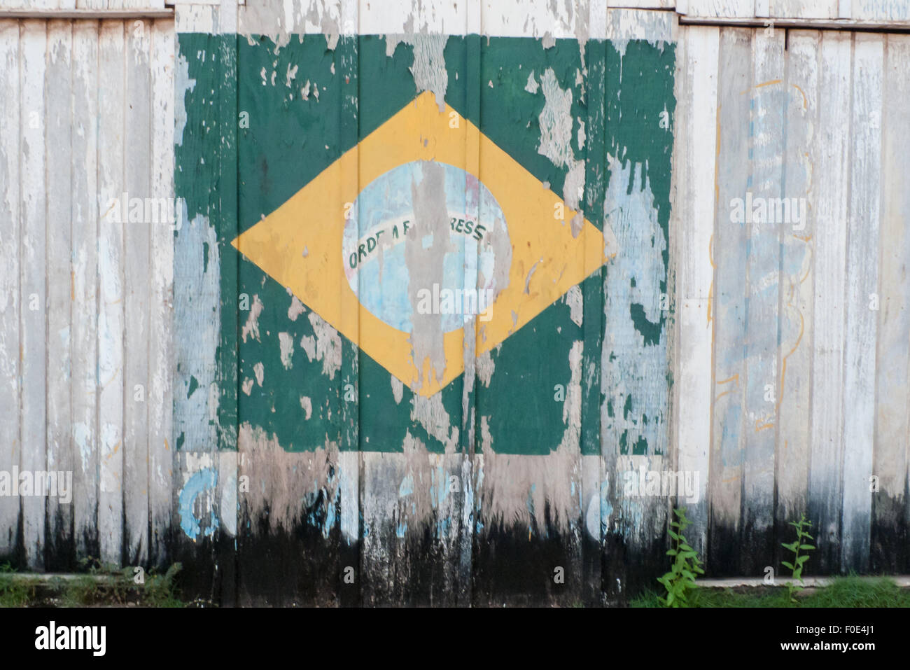 Novo Progresso, Para State, Brazil. Faded painted Brazilian flag on a wooden wall. - Stock Image