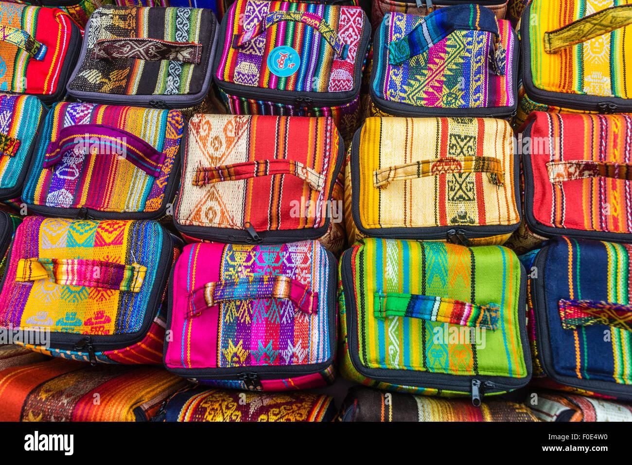 Colorful bags displayed at souvenier shop in Otavalo, Ecuador - Stock Image