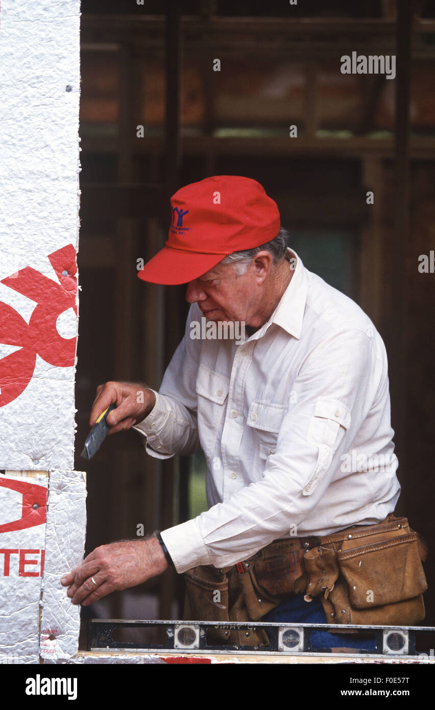 Atlanta, GA, USA. 19th Aug, 1992. Former President Jimmy Carter works on Habitat for Humanity house in Atlanta, - Stock Image