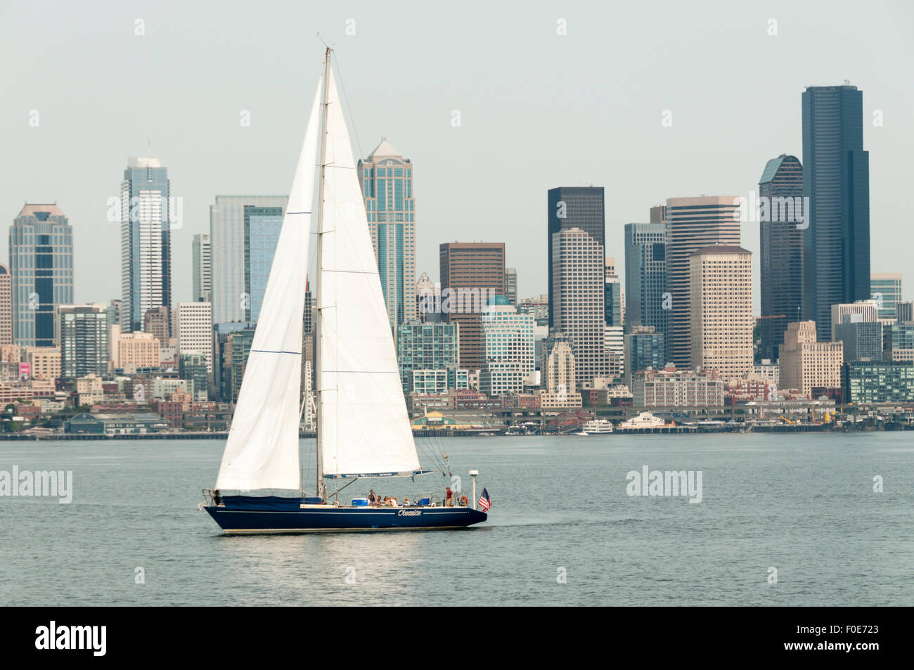 The charter yacht Obsession leaves Elliott Bay with the Seattle skyline in the background. - Stock Image
