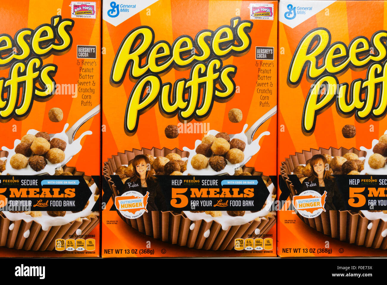 Reese's Puffs with Feeding America and Outnumber Hunger logos. - Stock Image