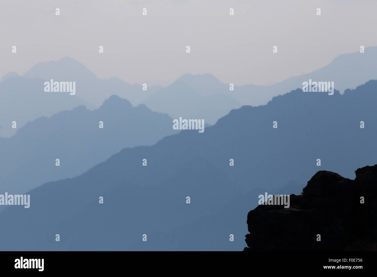 Abstract photo of distant mountain peaks in northern Italy (vista seen from Monte Baldo at lake Garda) - Stock Image