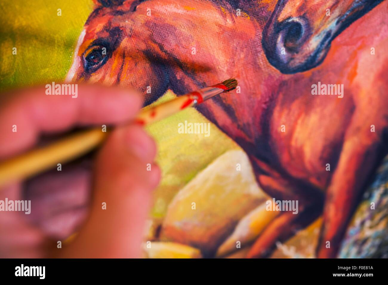 Painting on Canvas. Horses Oil Painting Closeup Photo. - Stock Image