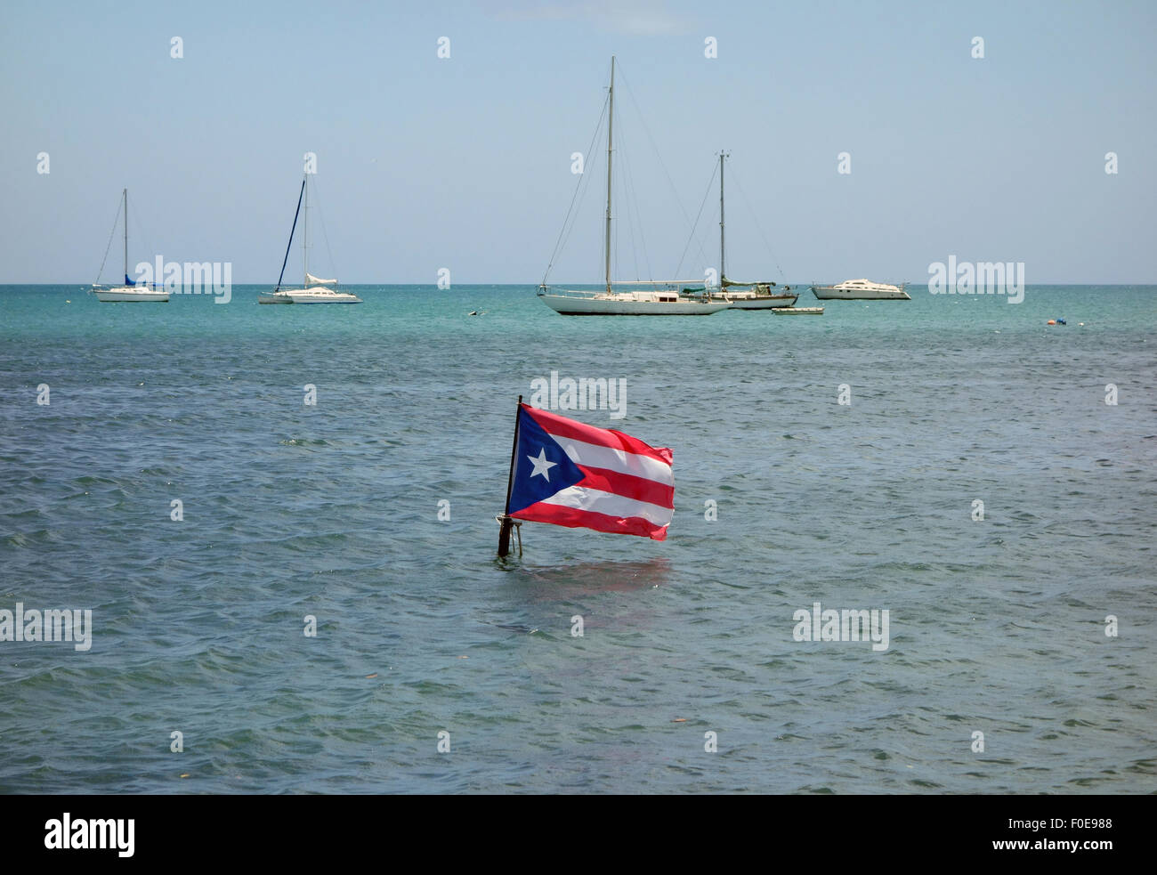 the Puerto Rican Flag appears to be sinking - Stock Image
