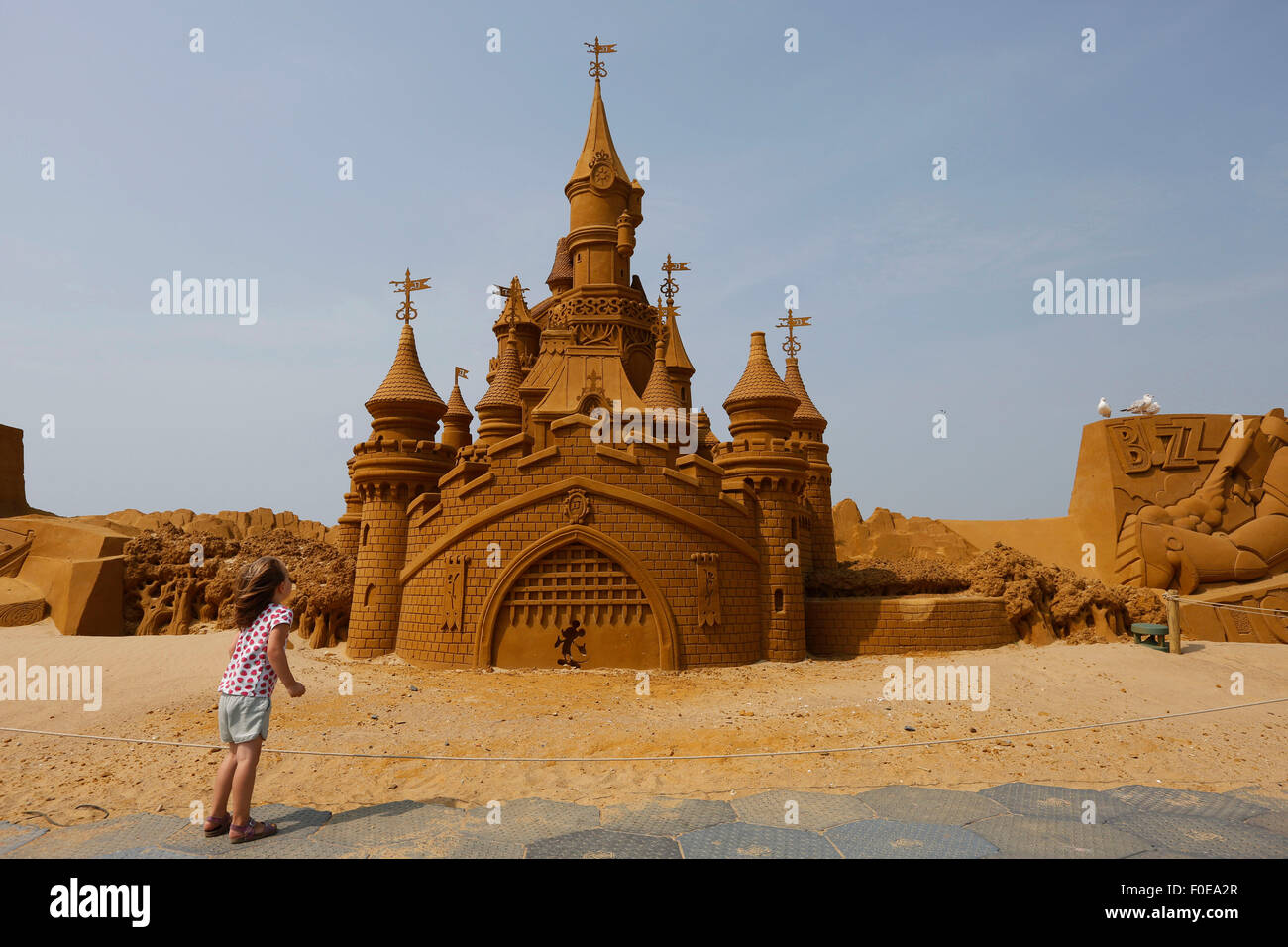 a girl looks at a castle shaped sculpture during the sand sculpture festival frozen summer fun in ostend belgium aug 13 2015
