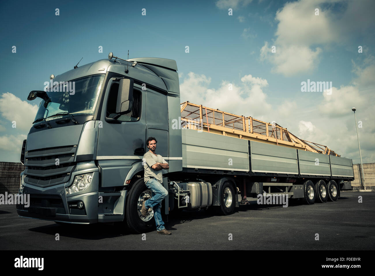 Truck driver with tractor trailer truck - Stock Image
