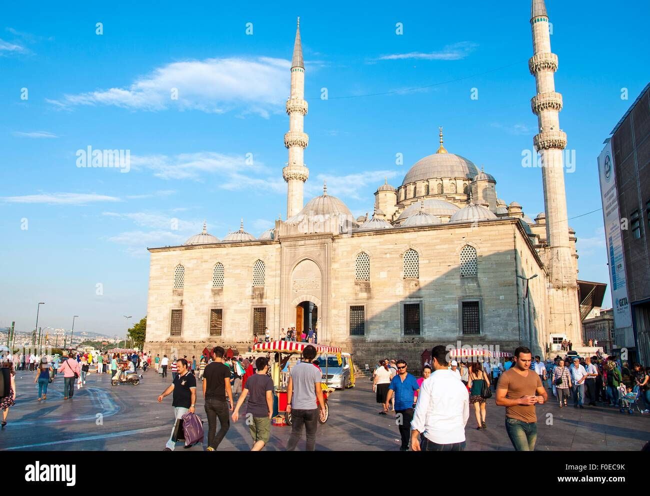 Istanbul, Turkey - August 11th, 2015: People leaving the Yeni Cami mosque after the afternoon prayer in Istanbul - Stock Image