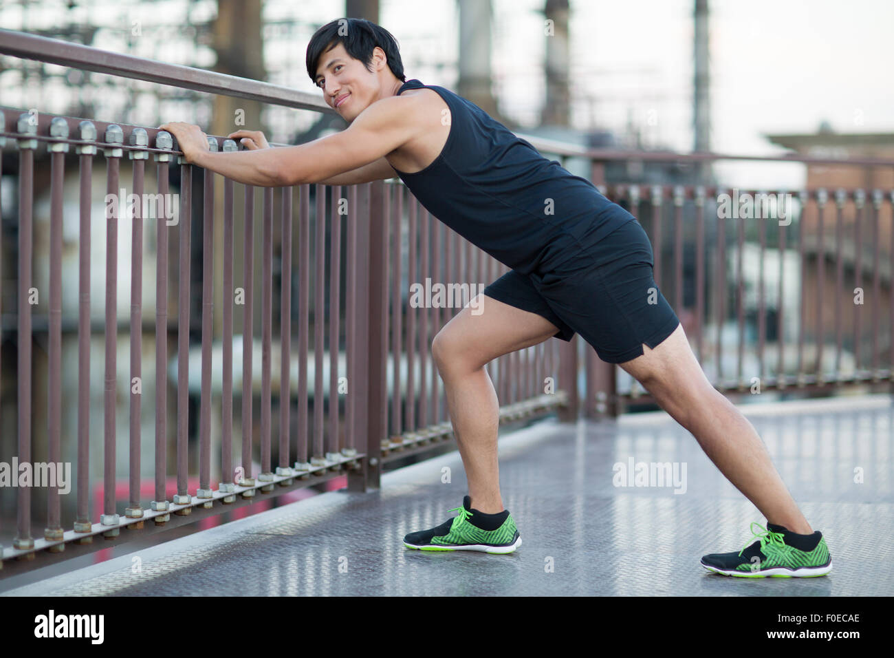 Young man exercising outdoors - Stock Image