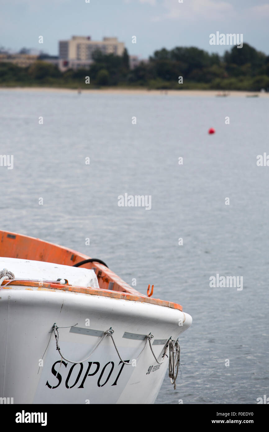 Detail of a safety boat in the marina of Sopot on the Baltic Sea. The name of the city Sopot is written on the boat. Stock Photo