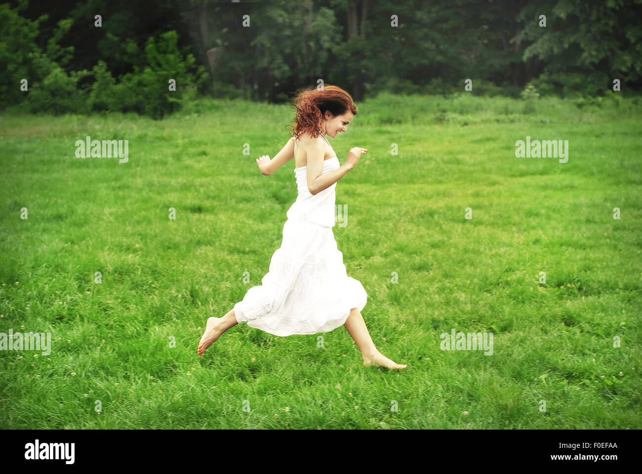 Pretty Girl Running Grass In Stock Photos   Pretty Girl Running ... 62d9356814a0